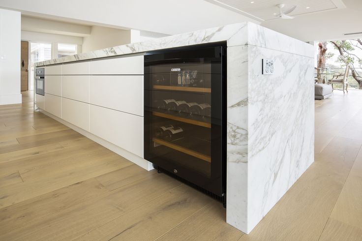 Vintec Wine fridge. Luxury entertainers kitchen with striking calacatta marble island.