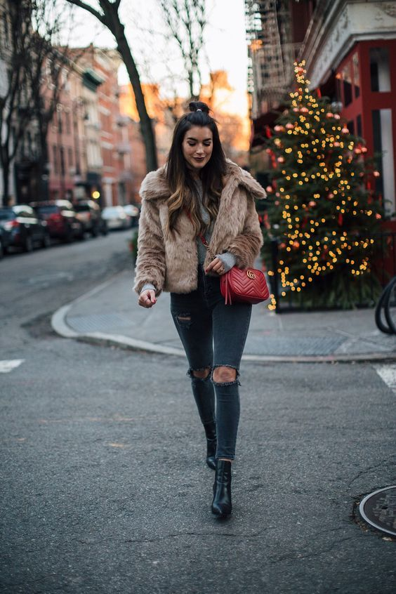 A faux fur jacket pairs perfectly with black skinnies, plain tee, and ankle boots. For more Faux Fur Styling ideas CLICK HERE