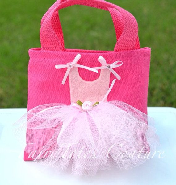 This small size ballerina tote is made with a durable pink canvas tote. It measures approximately 5 x 6. It is embellished with a tulle skirt, felt, ribbon rose & two ribbon bows. Two acrylic pink gems are added to the bows for a little sparkle. If you would like more than 5 totes you can send a convo with the number of totes you would like along with your zip code and I will let you know shipping costs. Ballerina Nail Polish Tutus & Tulle Wands also available on FairyTotes Couture....
