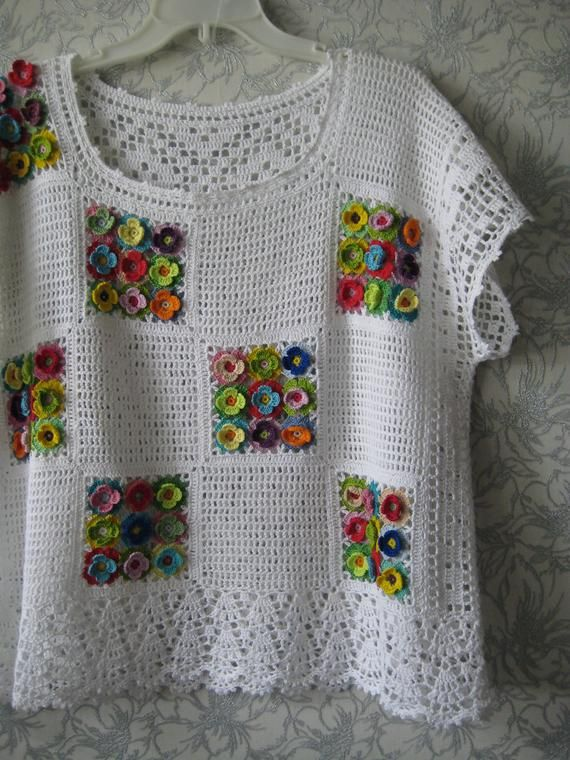 White crochet top with voluminous multi-colored flowers. Ready to ship
