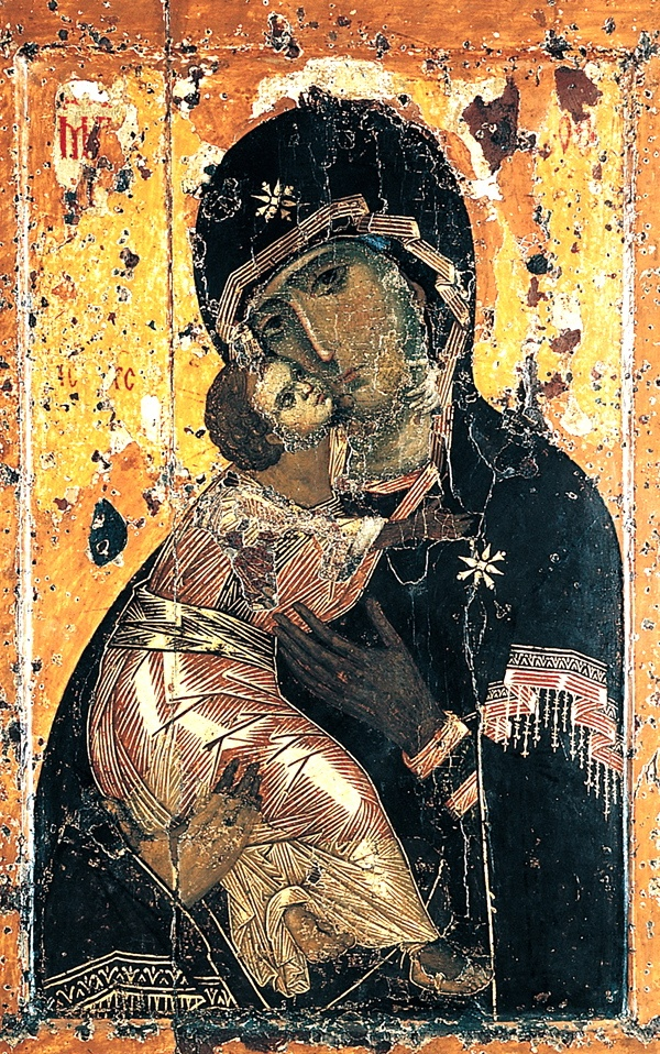 ICON: Vladimir Madonna, 12th century, egg tempera on wood, State Historical Museum, Moscow.  The icon can be recognized by the arm of the Child around the neck of the mother. The face of the Virgin that is looking towards us is full of warmth and human comprehension, but also with deep sadness.