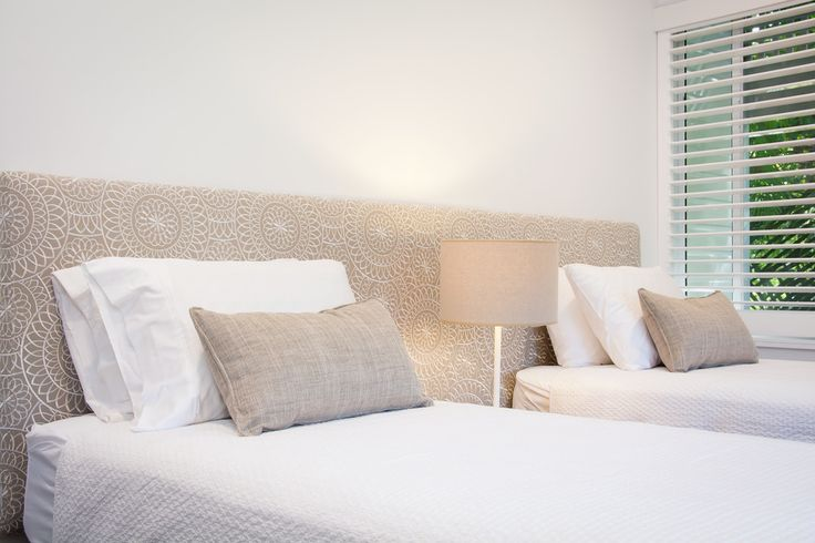MOKUM'S 'MEDALLION' BEDHEAD, LAMP BY MRD HOME AND LINEN BY LINEN AND MOORE