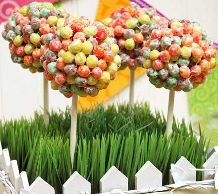 Colorful Cereal Maraca Treats for Kids-  4 teaspoons butter  4 cups mini marshmallows  10 cups colorful cereal {Trix}  8-inch lollipop sticks