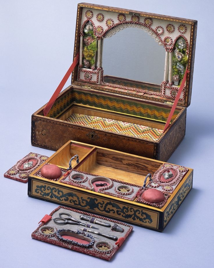 Sewing Box Late 18th century Straw-work sewing box, decorated all over with parquetry. The exterior of the lid is inlaid with sailing ship and townscape marquetry, and there are traces of coloring. Inside surfaces of the box also have parquetry decorations, pigmented with a variety of colors. Straw-work, which was produced throughout Europe in the 18th century, is a craft that involves splitting straws open lengthways, flattening them out, then gluing them together onto paper to form a ...