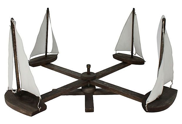 """1940s weathered mahogany sailboat whirligig from Rhode Island with original stand for rotating. """