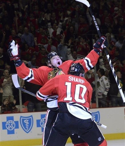 Marian Hossa celebrates after scoring on a power play in first period action during Game 1 of an NHL hockey playoffs Western Conference semifinal in Chicago, Wednesday, May 15, 2013. The Blackhawks won 4-1.(AP Photo/Daily Herald, Bob Chwedyk)