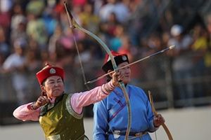 Women from Mongolia take part in an archery demonstration.