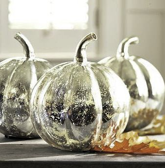 Buy cheap plastic pumpkins, prime w/flat white paint, let dry. Then spray with Looking Glass Spray paint Tm. Let dry. VIOLA! CHIC!!!