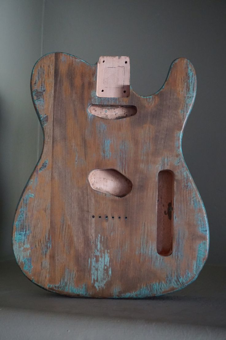 Light oxidized metal effect on a mahogany guitar