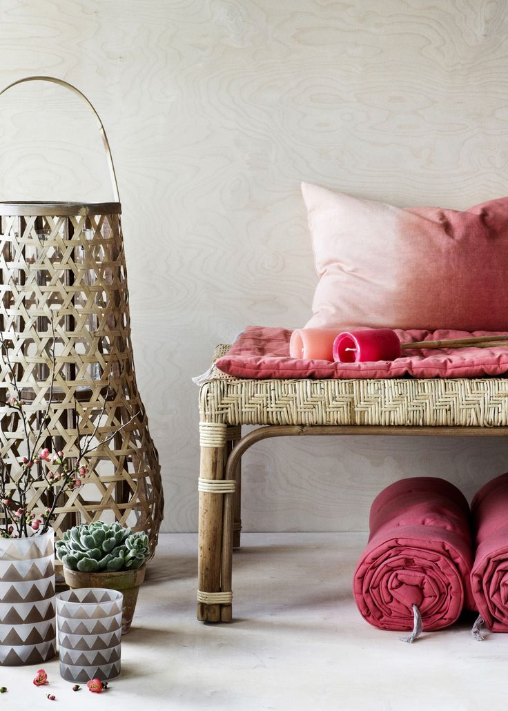 Rattan lantern and red shades #lantern #cushion