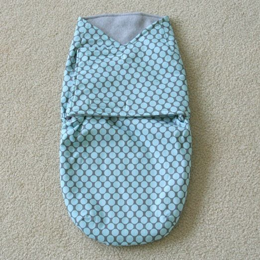 I've been meaning to try out the straight jacket swaddler pattern from this book after I checked it out at my local library. This was an easy pattern, probably not for a beginning sewer…