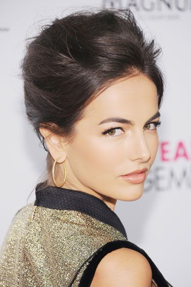 Breezy Chignon + Bold Brows  To capture the wind-swept texture of Camilla Belle's look, spray dry shampoo through strands and lightly back-comb pieces around the crown.