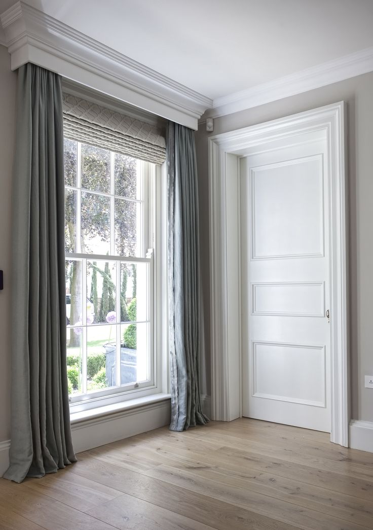 Long grey drapery panels hung on rod hidden beneath ~ boxed in ~ crown molding and 1 large shade beneath