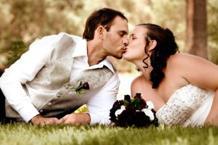 Wedding Photography, couple kissing on the grass