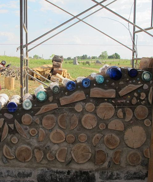 Good blog about Cordwood Construction.  I have been interested in this for a long time.  love it with the bottles! beautiful!