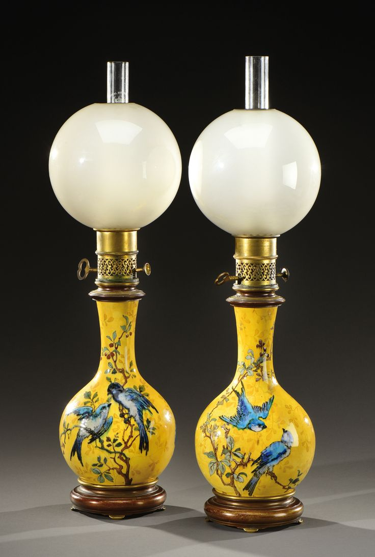 """THEODORE DECK attributed to  Pair of baluster shaped lamps ocher background with a decorative floral and bird polychrome.  Bronze Setting signed """"Gagneau"""" and globes glass. Towards 1890-1900."""