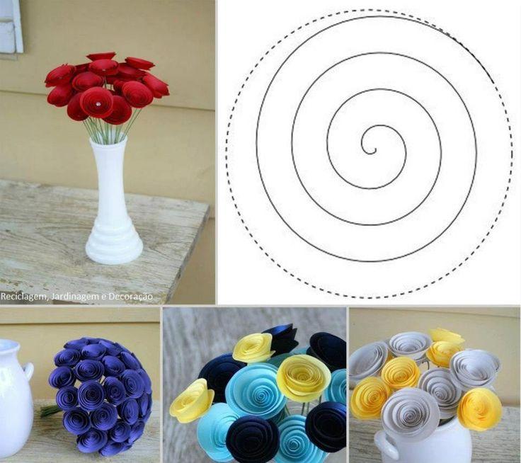 Flores de papel, um círculo com corte em espiral. Pode finalizar com uma pérola no centro, cola e arame.
