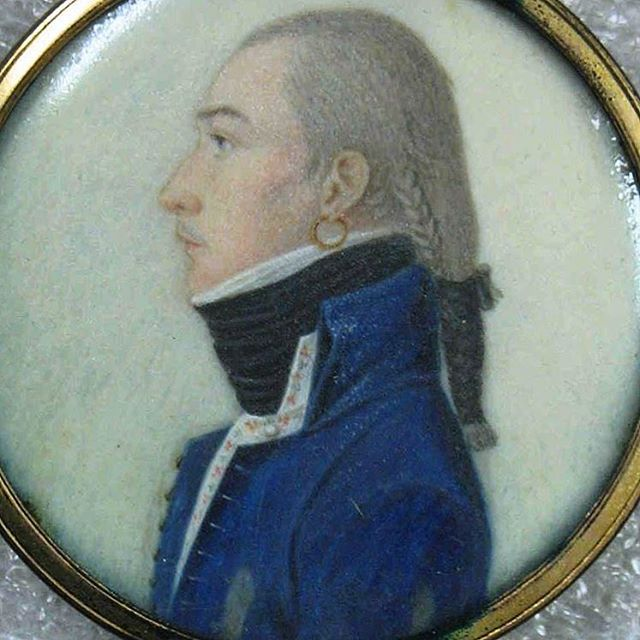 """For #bluemonday and #miniaturemonday, the dandiest of #dandies, with #braids, a gold hoop #earring, and a huge #cravat. #Incroyable! (Unknown artist, """"Portrait in Profile of a Young Man,"""" ca. 1790s, #watercolor on #ivory in metal #locket.) #portrait #profile #bluejacket #powderedhair #goldearring #hoopearring #frenchrevolution #mensfashion #18thcenturyfashion #fashionandpolitics #dandyism #dandy #incroyables #brooklynmuseum #brooklynmuseumcollection"""