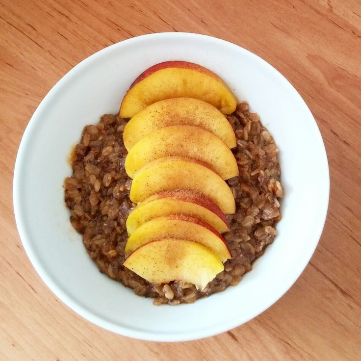 Peanut butter protein oatmeal with peanut butter, chia seeds and nectarine slices.