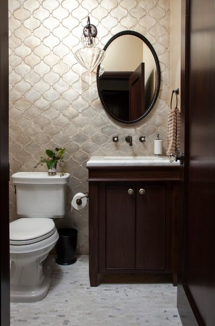 The wall tile is very wonderful. I don't think that the carrera matches, I would have gone with something more creamy, or a bordeaux. mediterranean bathroom by Plath & Company