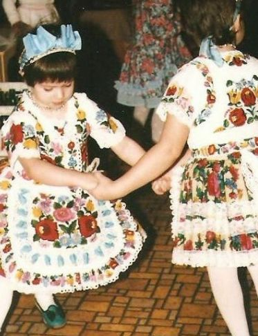 This picture was taken in a South Hungarian village around 1993 .Little girls are dancing at the party while dressed in the folk costume kalocsai style - made by their grandmas