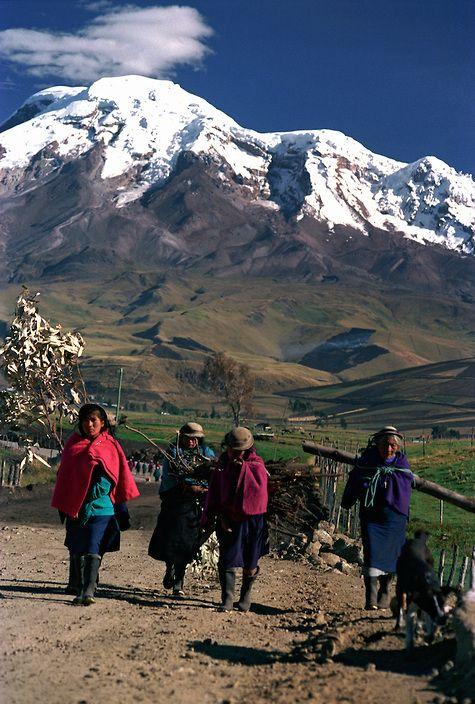 Indigenous People Walking on Dirt-road under Chimborazo, Ecuador's Highest Peak  | Petr Svarc Images