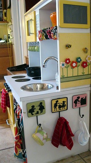Home-made toddler kitchen with running water! Love the silhouette potholder hooks. If anyone wants to make one of these for me, feel free!! :)