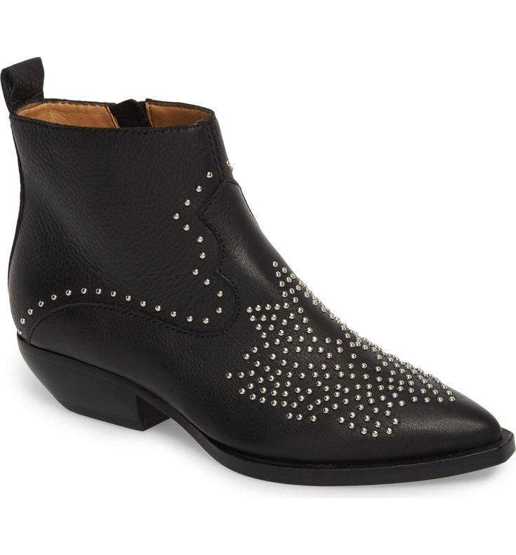 A constellation of polished studs bursts across the vamp of an entrance-making bootie kicked up on a dramatically tapered cowgirl heel.