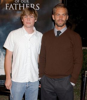 "Paul Walker and his brother take to the red carpet at the ""Flags of Our Fathers"" premiere in Los Angeles. Walker starred in the Clint Eastwood film in 2006."
