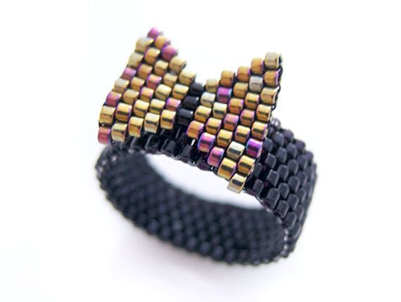 Gold Bow Beaded Ring Black Ring Preppy Style by JeannieRichard.  Found on Etsy - $17.50.  Inspiration!  So Cute!