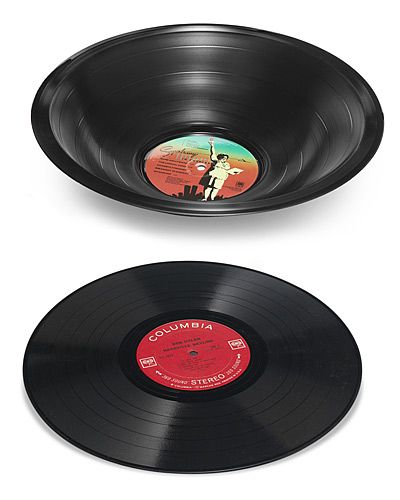 """melted record - Take record, place in oven at 150F (on a glass or metal bowl) watch for the 15 secs it takes to """"flop"""", remove from oven, quickly """"mold"""" into into the shape you want."""