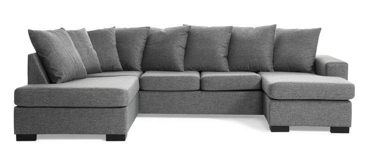 Modern soffa med schäslong till höger och divan till vänster med lösa kuddar i ryggen.