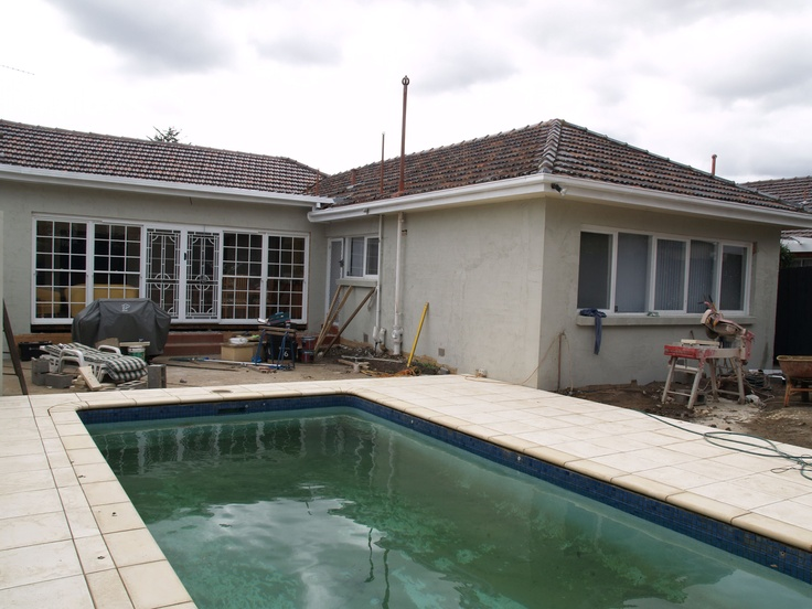 Pool surround paved and the house rendered