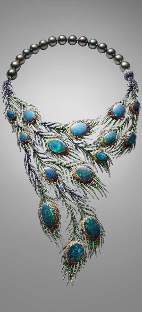 This beautiful necklace is part of a suite that includes earrings, a bangle and a ring, Alessio Boschi's Plumes necklace takes the peacock tail as its inspiration and uses 15 black opals as the centrepieces of cascading and movable feathers.