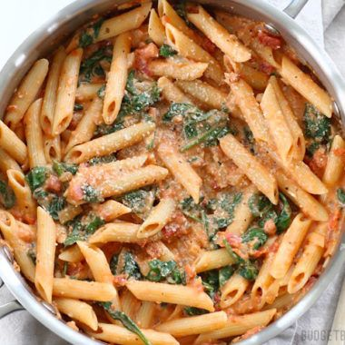 Easier than a box meal, this creamy tomato and spinach pasta is also more flavorful and delicious. 100% real ingredients. Step by step photos.