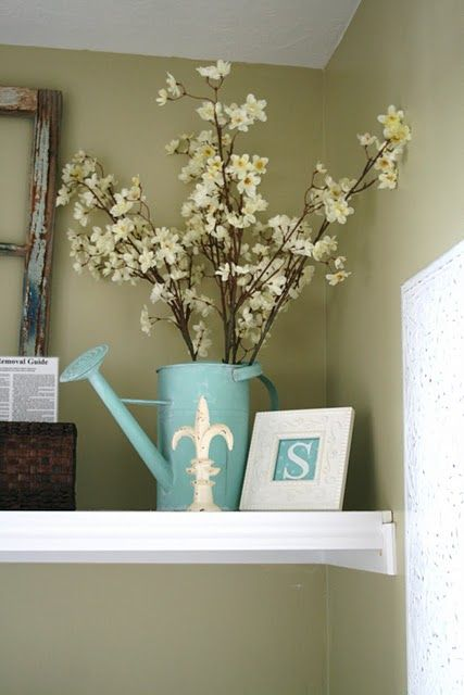 I have a watering can like this....I should find some stems! :)   (The House of Smiths - Home DIY Blog - Interior Decorating Blog - Decorating on a Budget Blog)