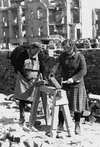 """Trümmerfrauen, German """"rubble women"""", cleared post-WWII city debris and were given extra ration cards for their efforts. Cities like Dresden and Berlin were slowly restored by women who were only given basic tools and used their bare hands for this hard labor."""