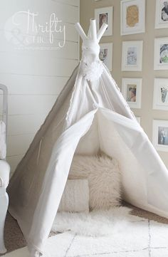 Build a small tent with PVC pipe and a drop cloth. So chic with the white-on-white, yet so easy and inexpensive.