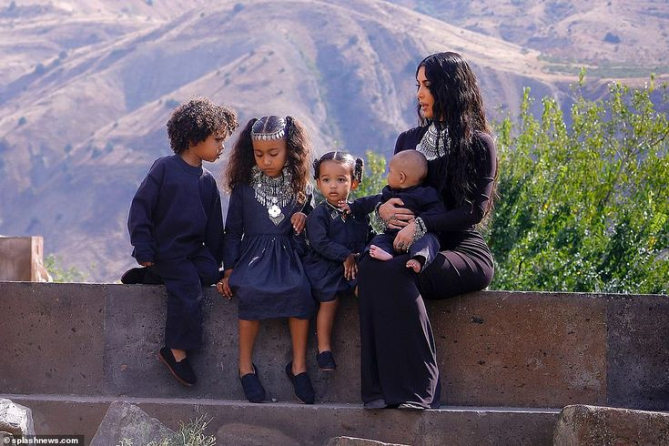 Kim Kardashian gathers youngsters collectively for household picture shoot as she remembers go to