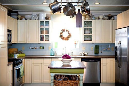 love it all - concrete countertops, repainted table-turned-island, repurposed pipes into pot rack