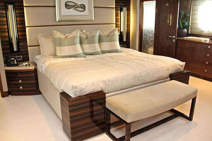 The Master suite onboard GiGi II. The master suite's king bed is designed to be the center of attention with all other room fittings having only one task - to frame the bed and amplify the luxury surroundings of this stateroom. This carries through to the full beam his and hers bath with a shared large center shower.Imagine spending your vacation here - ask us how at www.oceanscapeyachts.com.
