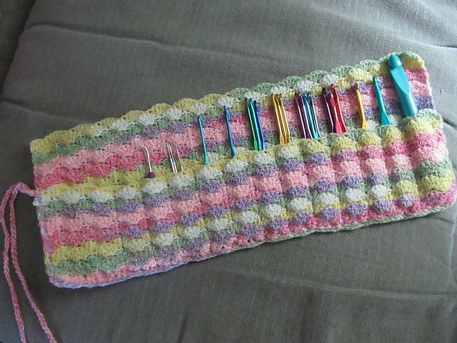 Ravelry: Crochet Hook Case - free pattern by Rachel Choi - yarn is Lion Brand BabySoft Print in Circus colourway, DK weight