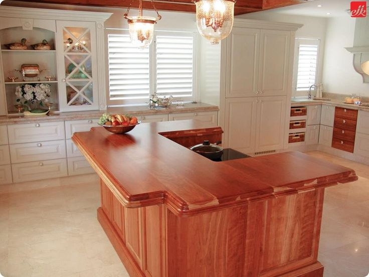 See how something as simple as feature lighting can change the entire look of your kitchen