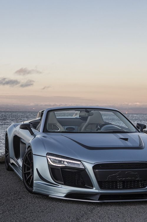 Beautiful pic of an Audi R8 convertible by the ocean. Don't be jealous. #funrides#sportscars#luxury