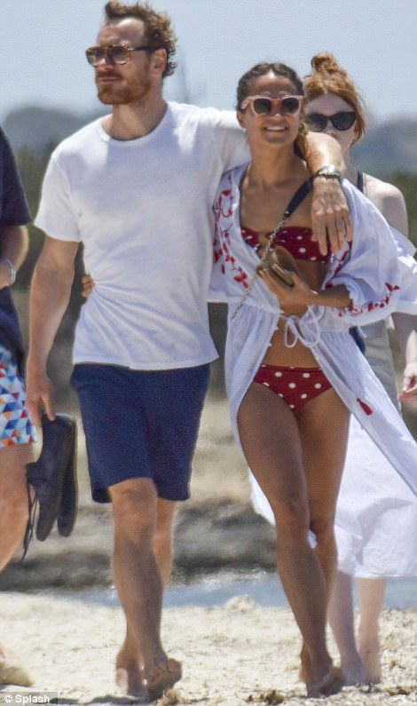 Giving him something to smile about! Shirtless Michael Fassbender beams as bikini-clad girlfriend Alicia Vikander displays her impressively ripped stomach during romantic Ibiza getaway Read more: http://www.dailymail.co.uk/tvshowbiz/article-4668508/Alicia-Vikander-Michael-Fassbender-loved-Ibiza.html#ixzz4lzml9KtJ Follow us: @MailOnline on Twitter | DailyMail on Facebook