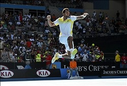Jo-Wilfried Tsonga celebrates after recording match point against Michael Llodra on day two of the 2013 Australian Open at Melbourne Park. (Pierre Lahalle/Presse Sports via USA TODAY Sports)