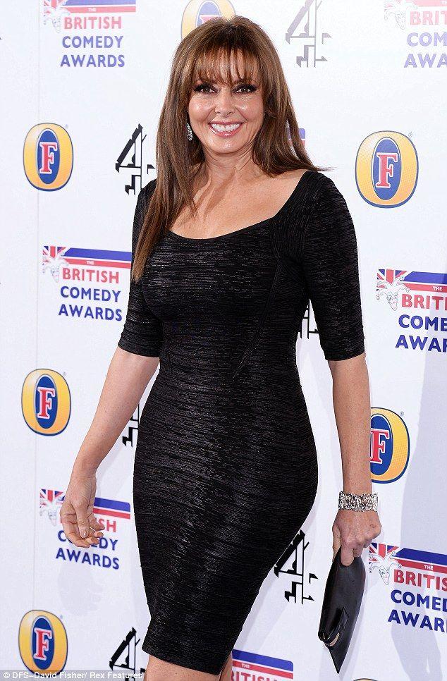Carol Vorderman looks stunning in a form fitting little black dress
