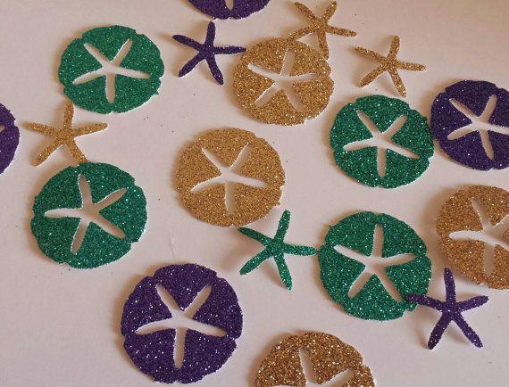 Listado es para 100 conteo de confeti de estrellas de mar arena dólar cada uno mide aprox. 1 se muestra los colores son oro y turquesa brillo púrpura, si necesitas diferentes colores házmelo saber. Perfecto para un tema de la boda de playa o en la parte de mar. Estos son perfectos para duchas nupciales, fiestas de cumpleaños, invitaciones etc.... Dispersión de éstos alrededor de la fiesta para toque!  POR FAVOR DEJAR FECHA NECESITABA AL FINALIZAR LA COMPRA RECIBIRÁ EN TIEMPO