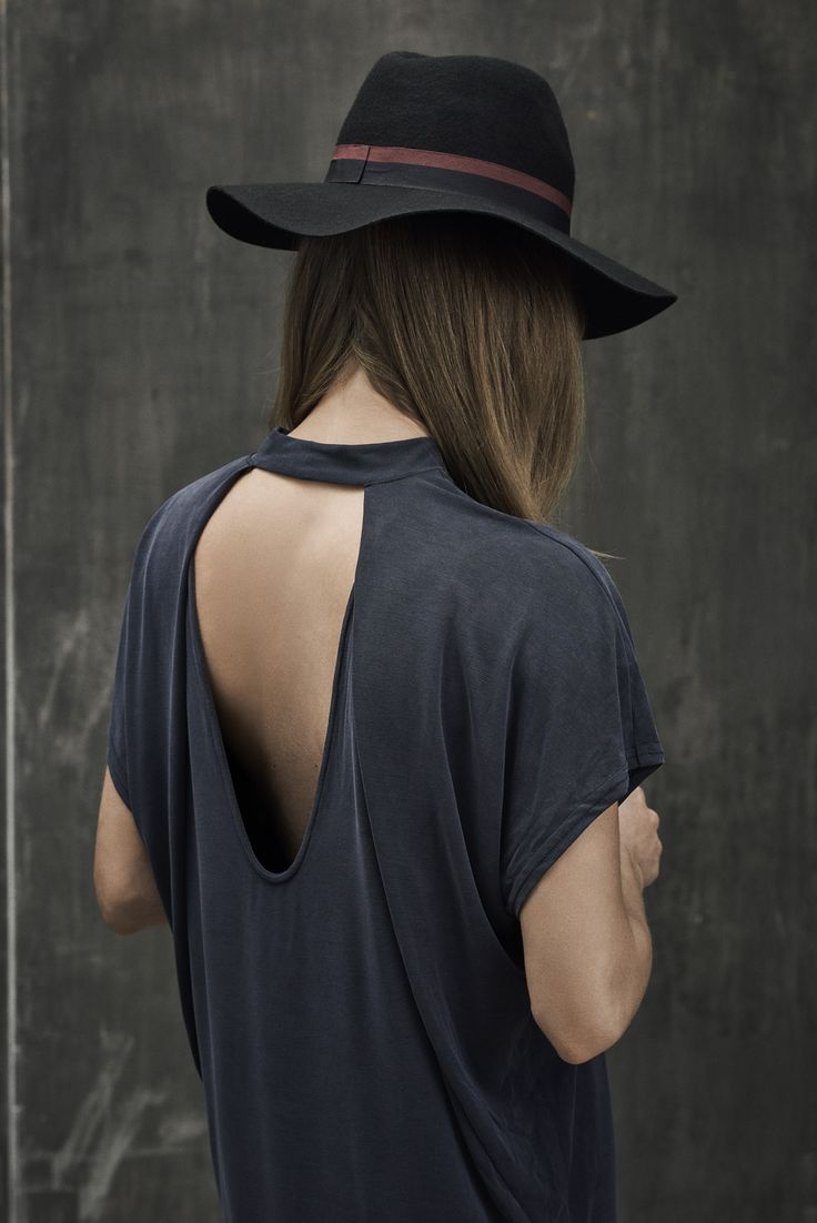 Blue loose shirt with a bare back.