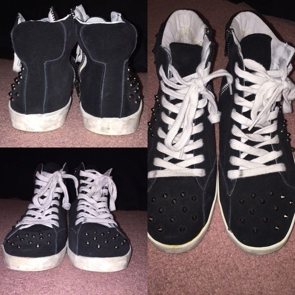 STEVE MADDEN Sudded High Top Sneakers Black Steve Madden High Top Sneakers with spike studs & white bottoms. A little worn, although only worn 2-3 times. Supposed to look dirty (hence dirty edges & shoe laces) but SUPER stylish!! (No original Box...so sorry!)Make an offer if interested!! Steve Madden Shoes Sneakers